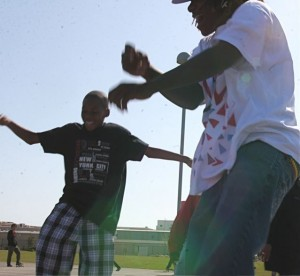 Teens dance at the 'Love Yo Mama' Earth Day event