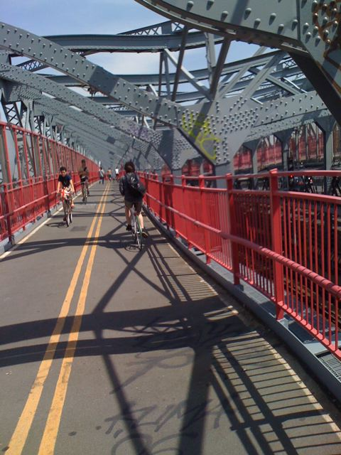 People riding up Williamsburg Bridge