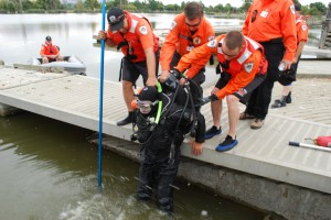 Workers with San Jose Search and Rescue aid a volunteer diver as he