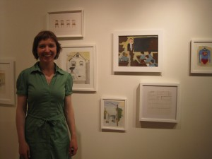 Artist Jenny Ottinger hangs her work at the Johansson Projects gallery.