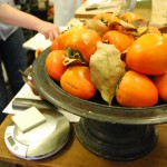 Persimmons on a footed platter in the Ici kitchen