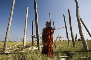 The photo of a monk stood in front of the monastery he is trying to re-build. Picture by Christopher Davy (www.christopherdavy.com)