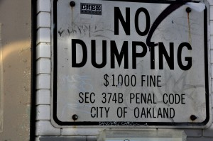 "The Oakland Public Works Department provides residents with free ""no dumping"" signs."