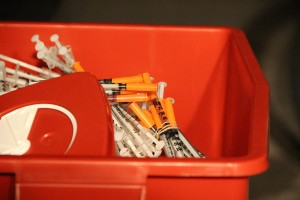 Used needles pile up in the medical waste bin at a recent HEPPAC syringe exchange.