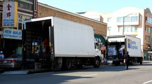 Trucks constantly move through the streets of Chinatown, parking near the curb to deliver shipments of produce and other items.