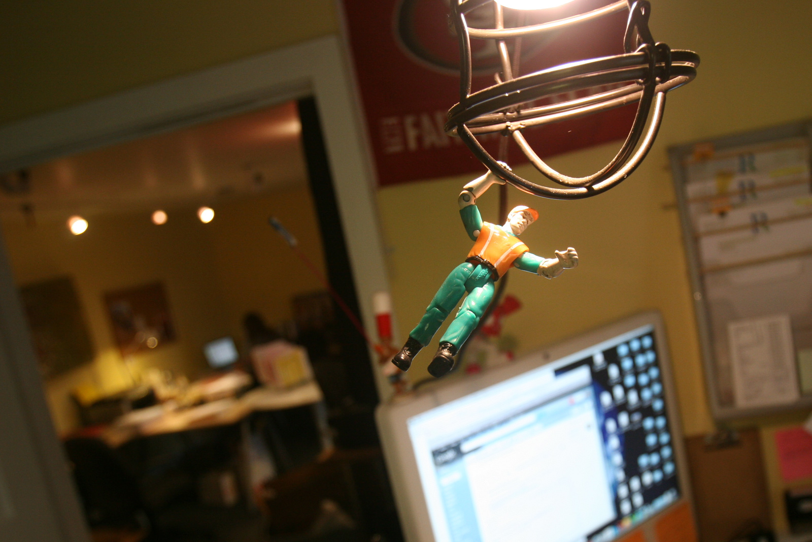 An action figure dangles from the light fixture in Ranahan Productions main office.