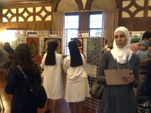 Nuns look at a work of art at the exhibition's opening in downtown Oakland.