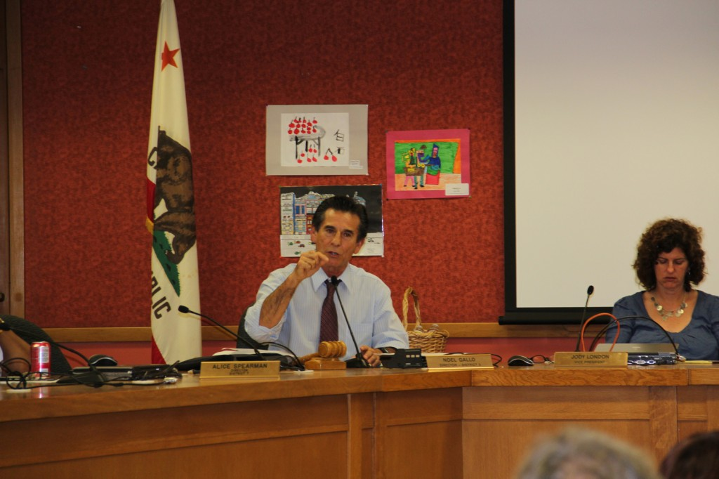 OUSD board member Noel Gallo addresses protesting parents, faculty, and staff from Kaiser Elementary School during a facilities board meeting Tuesday.