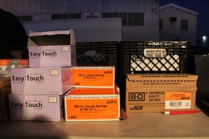 Boxes of new syringes wait to be distributed at HEPPAC's Thursday night deep East Oakland exchange.