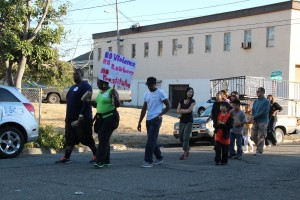 Supporters march through the San Antonio neighborhood