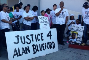 Adam Blueford, father of Alan Blueford, addresses the crowd of about 50 supporters outside the Eastmont substation for the Oakland Police Department.