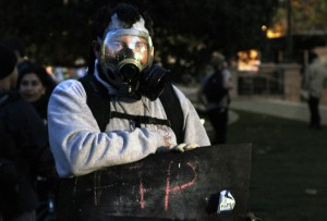 Others brought their own gas masks. Photo by Charles Berkowitz.