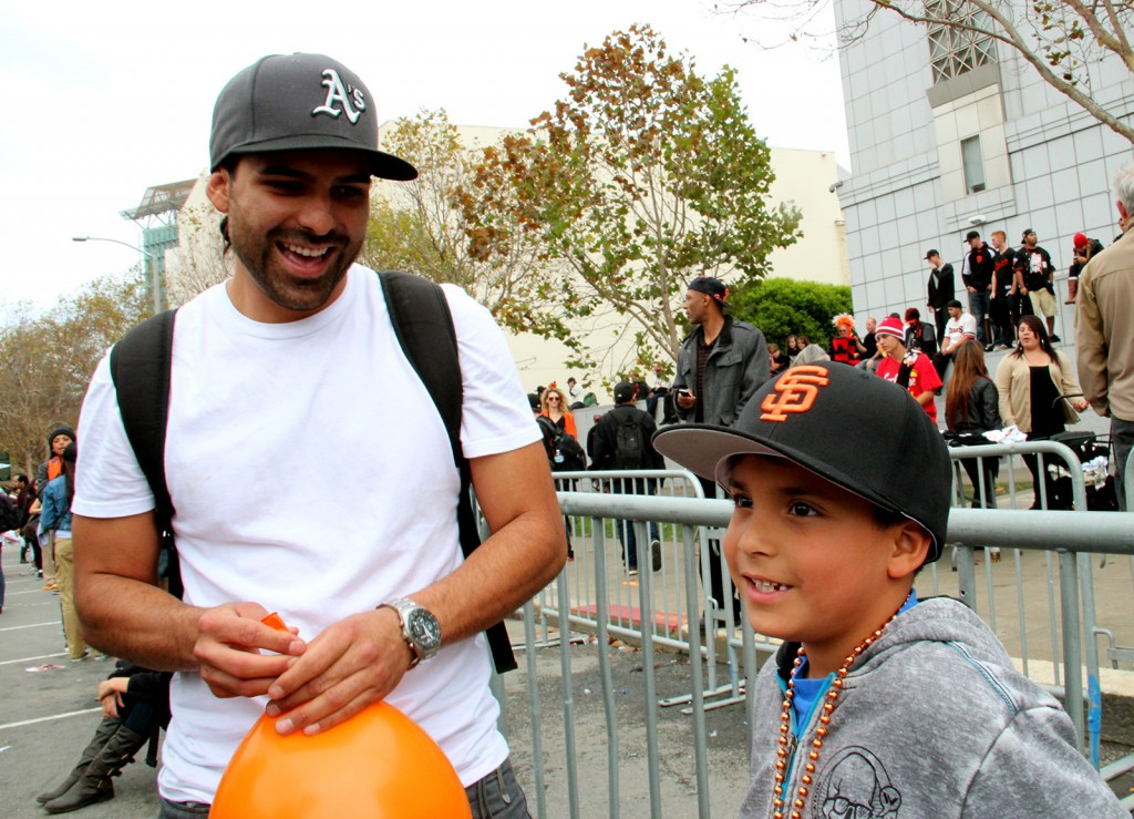 Zack (left) and his son Julien Etnyre have split baseball loyalties, but little animosity when it comes to the Giants victory. Photo by Mihir Zaveri.
