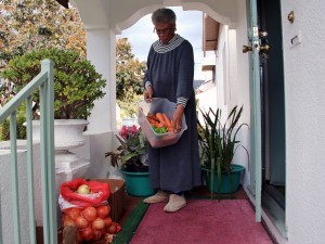 The produce Jessie Mae Brown, 85, leaves on the porch of her East Oakland home helps to feed most of her block.