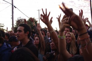 "The crowd puts three fingers in the air in recognition of the anniversary of the release of Souls of Mischief's ""93 Til Infinity."" Photo by James Reddick."