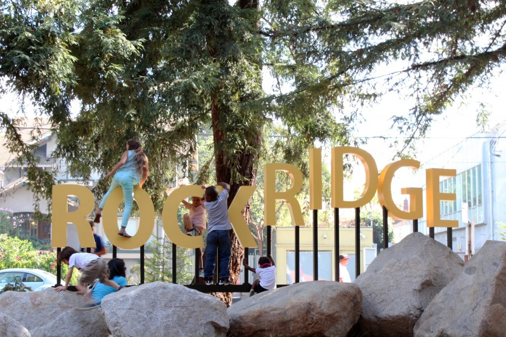 Kids play on large Rockridge sign.