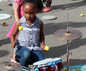 Girl plays drums.