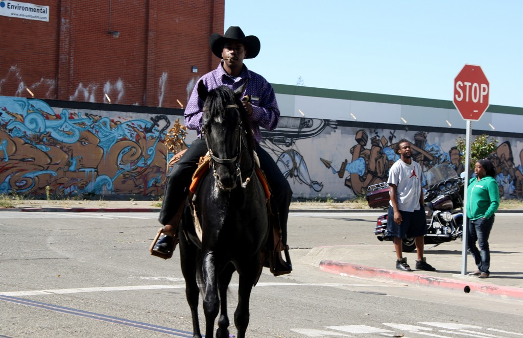 A photo of a cowboy on horseback at the parade.