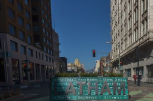 This sign in Latham Square is made of metal and repurposed street signs.