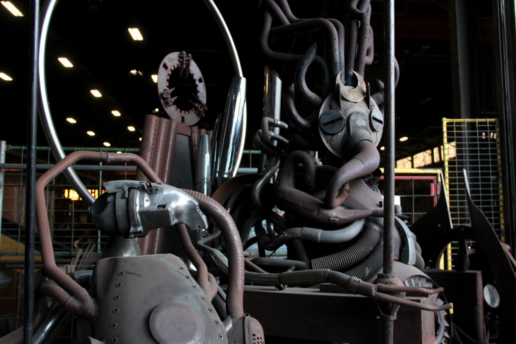 """A """"gargoyle"""" made by artist Ryon Gesink from recycled motorcycle and car parts at the entrance to American Steel Studios. Photo by James Reddick."""