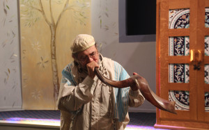 Rabbi David J. Cooper practices blowing the shofar before the Jewish High Holidays.