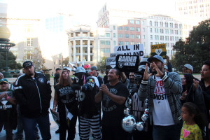Members of Forever Oakland and Raiders fans gather in front of City Hall