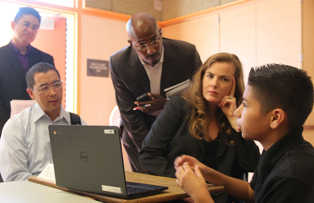 A student at Urban Promise Academy explains his use of Google Drive for team projects to visitors, including Van Jones.