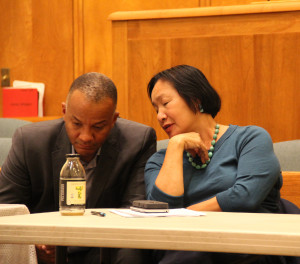 "7:30 p.m. Parker and Quan chat in between questions about how to keep Oakland's three sports teams, the Warriors, Athletics and Raiders in Oakland. ""We can't finance a football stadium on 11 games a year,"" Quan says – a sentiment echoed by many of the other candidates. Photo by Sasha Lekach."