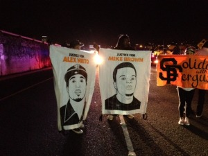 Protesters' posters compare Mike Brown with Oakland native Alex Nieto. Photo by Bonnie Chan.