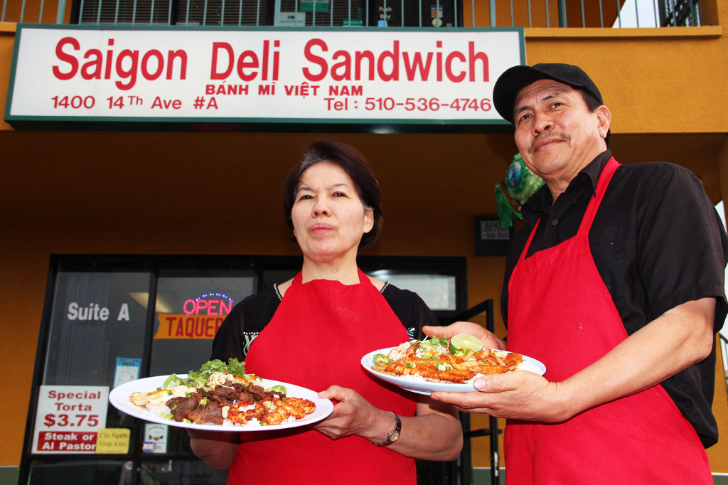Co-owners Dieu Thi Ngo and Tony Torres pose before Saigon Deli (& Taco Valparaiso), a Vietnamese and Mexican restaurant they opened more than three years ago.