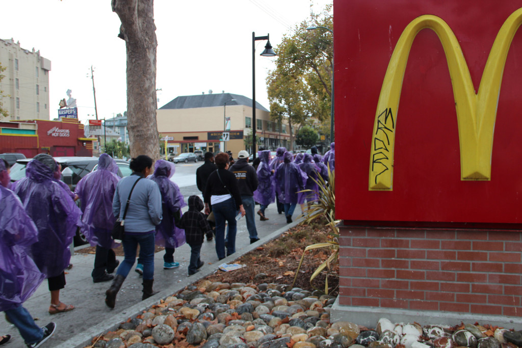 Environmental and labor activists march to a demonstration in a North Oakland McDonalds.