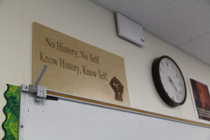 "A sign reads ""No History, No Self. Know History, Know Self."""