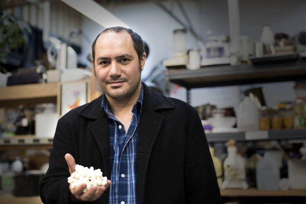 Anthony Di Franco, cofounder of Counter Culture Labs, holds a 3D printed model of the insulin molecule.
