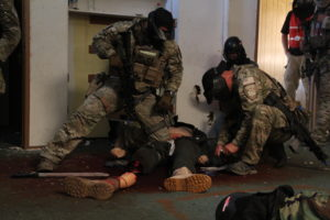 Oakland Police Department officers train in a terrorist and hostage scenario during Urban Shield.