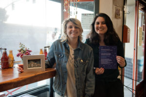 Alexia Webber (left) with her diorama of an untitled original poem by Sandy Frank (right.) Photo by Rosa Furneaux.