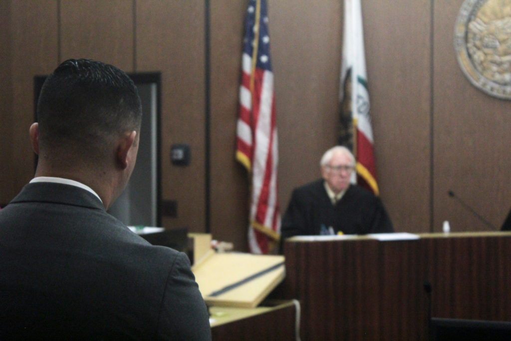 Contra Costa County Sheriff's Deputy Ricardo Perez, left, enters a not guilty plea at the Hayward Hall of Justice.