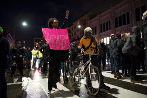 Protesters pause at an intersection on Broadway. Photo by Rosa Furneaux.