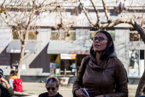 Navajo activist Wahleah Johns speaks near Oakland City Hall before the march. Photo by Pablo De La Hoya.