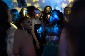 Teens at Kaiser Permanente Pediatric Prom sing along on the dance floor.