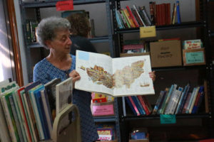 Redni Voorhies is a retired school teacher and former librarian who began volunteering in 2010. Using her expertise in books, she walked around the room, excitedly giving helpful suggestions to those selecting books.