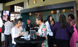 "People who came to the ""Let's Love Coco"" fundraiser event are communicating with each other."