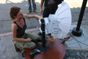 Sudo Mesh co-creator Jenny Ryan makes a few tweaks to the ad-hoc AirFiber test setup.