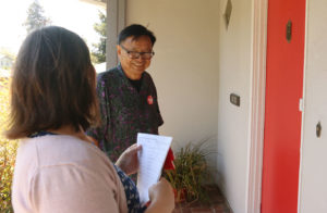 Gary Yee knocking on doors with supporter Lacy Asbill in the Lincoln Highlands.