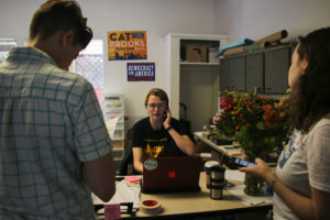 "Katie Tertocha, volunteer coordinator at Cat Brooks' headquarters making last minute gotv calls. ""We wanted to make it as easy as possible for people to vote."" Photo by Annie Berman."