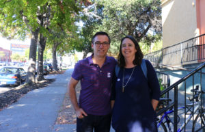 Sara Buckelew and Eric Bottino, Oakland voters who are married, after entering their ballots. Photo by Carla Williams.