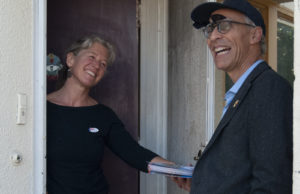 Oakland City Councilmember Dan Kalb canvased with District 4 candidate Nayeli Maxson on Tuesday morning. He spoke with voters like Kristen Zimmerman, who had already voted, and others who are still researching candidates and measures on the 4-page ballot. Photo by Sarah Trent.