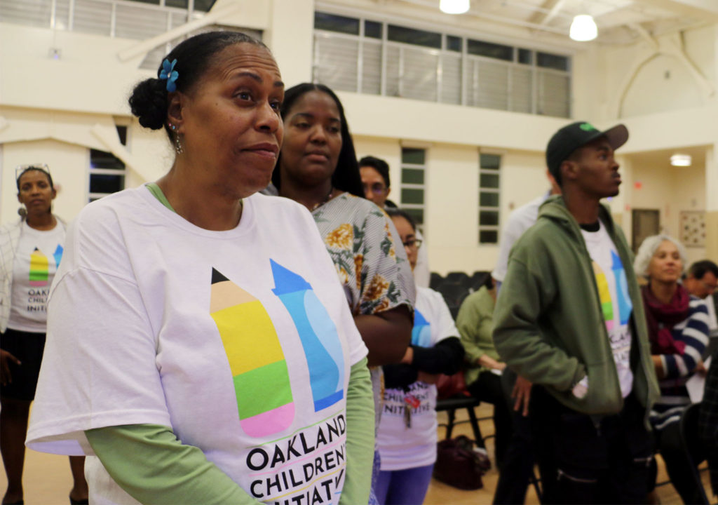 Supporters of Measure AA, also known as the Oakland Children's Initiative asking for the Oakland school board's support at a meeting in September 2018. The fate of the measure remains in a legal limbo. (Photo by Mickey Capper)